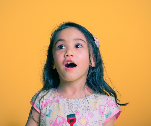 Girl talking out loud.