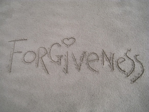 Forgiveness written in the sand.